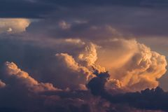 Storm clouds. At sunrise with reddish colors royalty free stock image