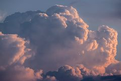 Storm clouds. At sunrise with reddish colors stock photo