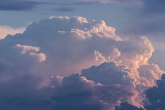 Storm clouds. At sunrise with reddish colors royalty free stock photography