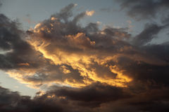 Storm clouds at sunset Stock Photos