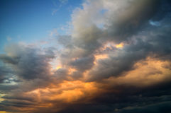 Storm clouds on sunset sky Stock Photo