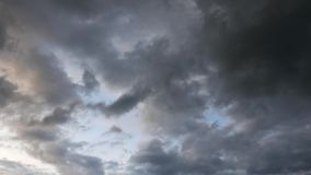 Storm Clouds Time Lapse 04. A time lapse video showing the motion and transformation of dark, grey storm clouds coming in stock footage