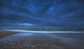 Storm clouds at twilight over sandy beach Royalty Free Stock Photography