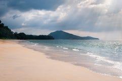Storm clouds under tropical sandy coast Stock Photo