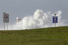 Storm on the coast. Storm on the portuguese north coast with huge waves invading piers and lighthouses against a beautiful blue sky Stock Photography