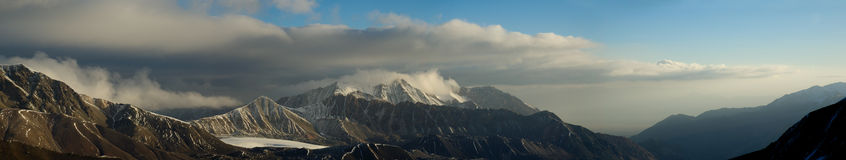 Storm comes. Panoramic view from Lenin peak icefall to neighbour mountains Stock Image