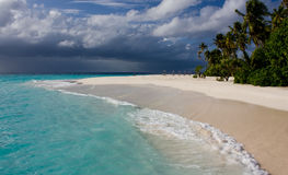 Storm is coming. Storm clouds brewing over a  tropical beach Royalty Free Stock Photo