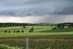 Storm Coming. Storm clouds rolling in over the fields royalty free stock photo