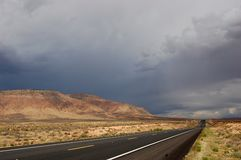 Storm is coming, Arizona road. A road near Grand Canyon, Arizona, under stormy skies Royalty Free Stock Photography