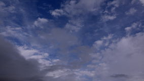 Storm coming in as time lapse clouds pass overhead 4K. Depression is on its way 4K stock footage