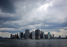 Storm coming over Mahattan, New York City. A panoramic view of Manhattan, New York City, from the Hudson river with heavy clouds stock photos