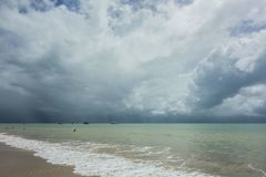 Storm is coming on the sea. Faraway , on the sea ,a storm is coming at the end of the day to clean everything.Lots of blue colouring  the landscape Royalty Free Stock Photos