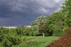 Spring landscape with dramatic sky The storm is coming! Threatening storm clouds over the green park Royalty Free Stock Images