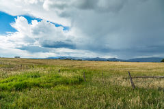 A storm coming. A thunder storm approaches from the mountains along US Highway 160 in Colorado royalty free stock photo