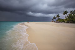 Storm is coming to the Maldives. Stormy weather with rain on the beach. Just a few minutes before storm in Maldives royalty free stock photos
