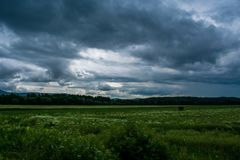 Storm comming to the field royalty free stock image