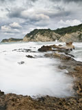 Storm in the Costa Blanca. Stormy seascape, with the waves breaking on the rocky shore. Pohoto taken in the Costa Blanca of Spain Royalty Free Stock Photos