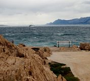 Storm. Croatian landscape in stormy weather. Mountains, sea, boat, rocks Stock Photo