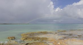 After the storm 2 - Cuba 2018. A rainbow spans open water between Coco Beach and the Playa del Boca isthmus in Camaguey province, Cuba, after a morning rainstorm Royalty Free Stock Images