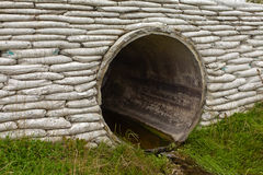 Storm culvert drainage pipe concrete revetment Stock Photo