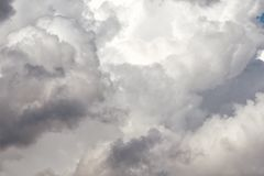Storm cumulus clouds, gray sky in rain. Bad weather background, autumn season royalty free stock images
