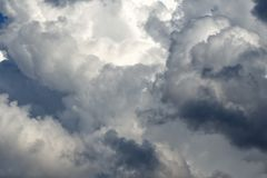 Storm cumulus clouds, gray sky in rain. Bad weather background, autumn season stock images