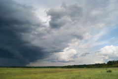 Storm cyclone over summer fields and forests Stock Photography