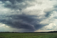 Storm cyclone over summer fields, hills and forests Stock Photography