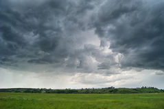 Storm cyclone over summer fields, hills and forests Royalty Free Stock Photos