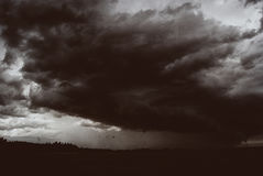 Storm cyclone over summer fields, hills and forests Stock Photo