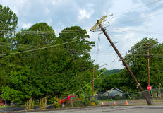 Storm Damage. A telephone pole leans after damage from a storm Stock Photo