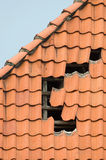 Storm damage. Showing the roof and roof beams of a building and some missing pan-tile Stock Photography