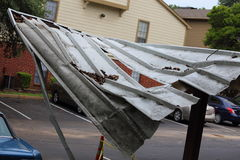 Storm Damage. A close up view of a carport damaged during a storm and tree branch Stock Photos