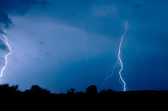 Storm on a dark blue sky Stock Image