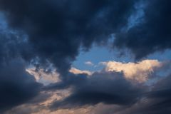 Free Storm Dark Clouds Against Blue Sky Background. Darkness And Light, Heaven Royalty Free Stock Photography - 147761897