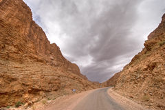 Storm in desert valley Stock Photos