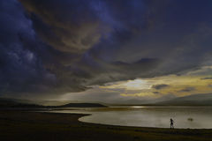 Storm developing over a lake Stock Photos