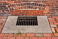 Storm Drain. A storm drain in the sidewalk Royalty Free Stock Photo