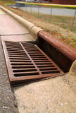 Storm drain. A storm drain by a roadside stock photography