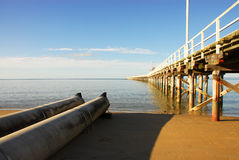 Storm drain next to pier Royalty Free Stock Image