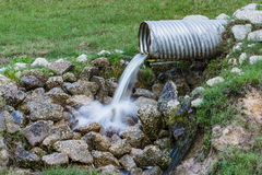 Storm Drain. Storm water flowing from drain stock images