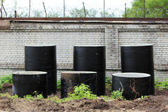 Storm drains from concrete rings are in two rows near the construction site for the construction of a stadium. Storm drains from concrete rings are in two rows Stock Images