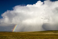 Storm on the Eastern Prarie of Colorado. An early spring storm produces a rainbow on the eastern plains of COlorado Stock Photos