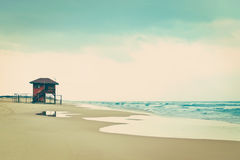 Before the storm empty beach, vintage style. Royalty Free Stock Photography