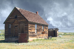 Storm on the farm. Old ranch structure with approaching storm Stock Photography