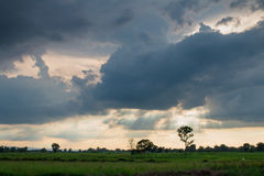 Storm formed Along with the sun. Through the clouds.dark tone Royalty Free Stock Image