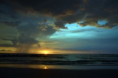 Storm forming above open sea. A storm forming above the open sea in the Gulf of Mexico off the central west coast of Florida at sunset Stock Image