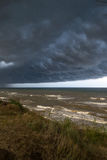 Storm front over water. Coming from coast Stock Image