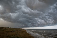Storm front over water with wall of rain. In the centre Stock Photography