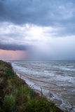 Storm front over water with wall of rain. In the centre Royalty Free Stock Photo